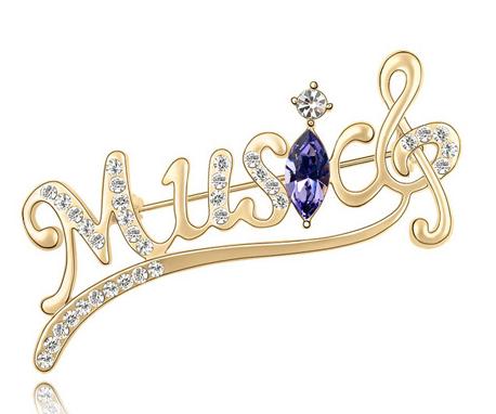 Brosa Music gold cu elemente Swarovski violet si placata cu aur 18K garantie 6 luni